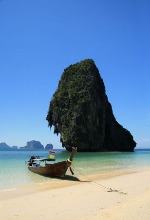 railey: traditional wooden long tail boat on tropical Phra Nang beach by happy Island, Thailand