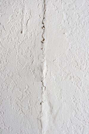 crack: cracked white plastered wall background