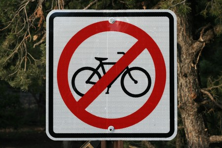 no bicycle sign with pine trees behind it Stock Photo - 6881821