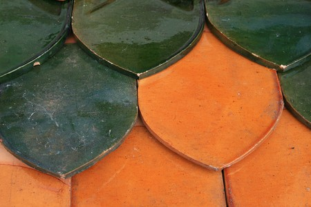 orange and green glazed ceramic tile roof detail from temple Banco de Imagens