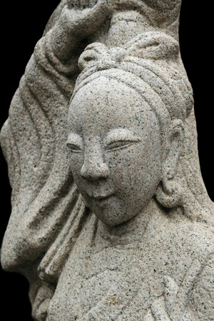 stone carving of an Asian woman from Thai temple with black background Stock Photo - 6881820