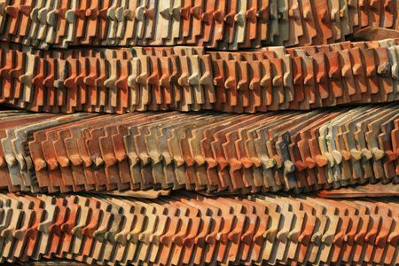 rows of ceramic tiles piled up during a temple restoration photo