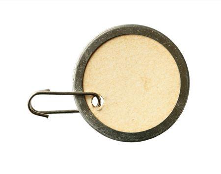 Vintage ronde karton en metalen tag op wit wordt geïsoleerd