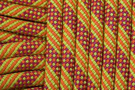 detail of a new orange, yellow, and red climbing rope Stock Photo - 7201847