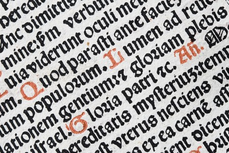 angled detail from 17th century woodblock book of prayer with latin text in red and black Stock Photo - 7266759