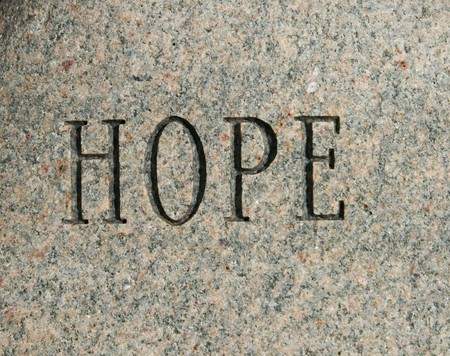 the word hope carved onto a granite cobble stone