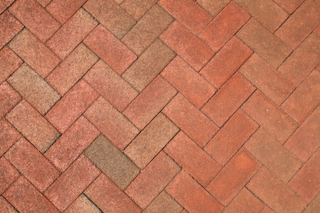 pavers: red brick herringbone background texture Stock Photo