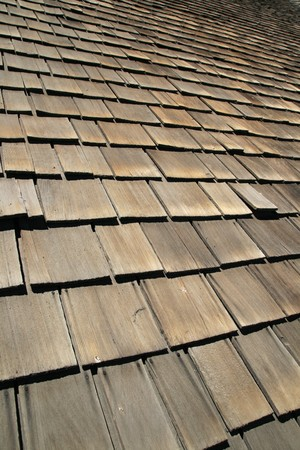 angled vertical image of old wooden roof shingles Stock Photo - 7785218