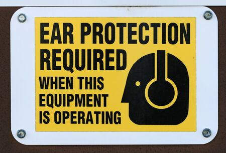 required: ear protection required sign posted on a door