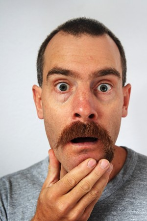 surprised man with uneven moustache trimmed more on one side than the other