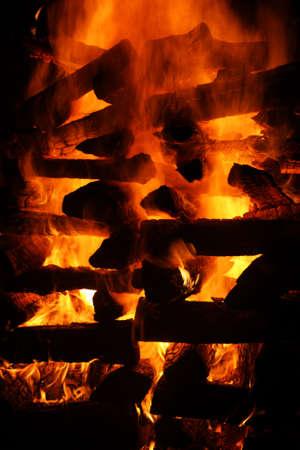 blazing log bonfire detail with black background Stock Photo - 8161211