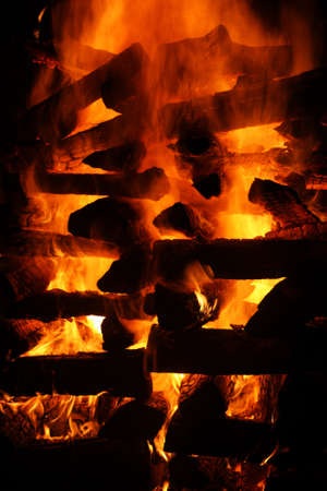blazing log bonfire detail with black background Stock Photo - 8161211