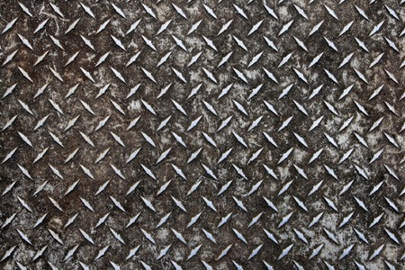 dirty worn old aluminum diamond plate non-skid surface background