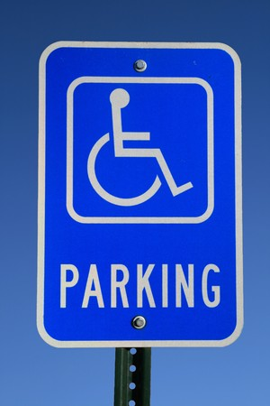 handicapped parking sign with blue sky background Stock Photo - 8161355