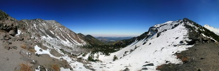 panorama of the San Francisco Peaks from the saddle on the trail to the summit of Mount Humphreys, the highest point in Arizona Stock Photo - 8161241