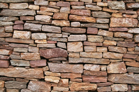 dry stacked sandstone stone wall background texture Stock Photo - 8234422