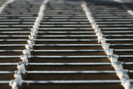 no skid: detail of a metal walkway with shallow depth of field Stock Photo