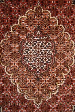 fine red persian carpet background texture Stock Photo