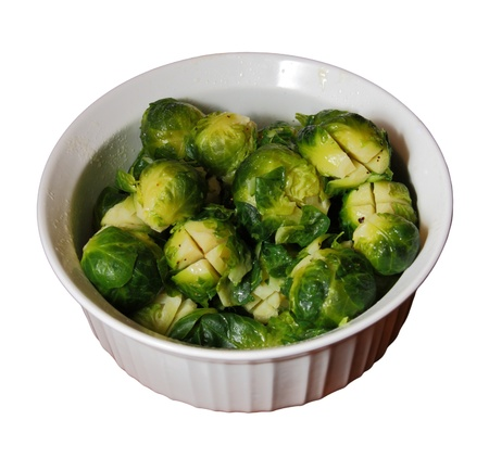 white bowl of cooked brussels sprouts isolated on white Stock Photo - 8334313