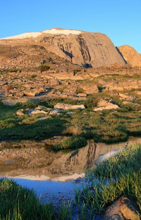 morning reflection of Wind River Peak in a small pool in the Wind River Mountains of Wyoming Stock Photo - 8379506