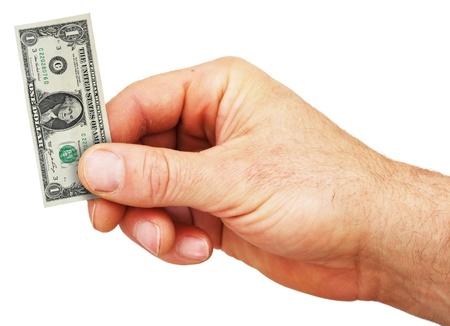 una mano sosteniendo un pequeño proyecto de ley de dólar de los Estados Unidos Foto de archivo