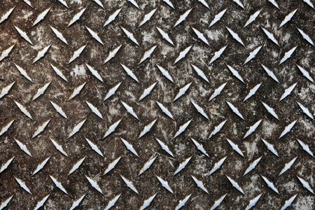 dirty worn aluminum diamond plate non-skid surface Stock Photo