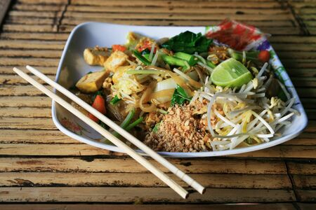 a plate of pad thai on a bamboo table in Thailand Stock Photo - 8488955