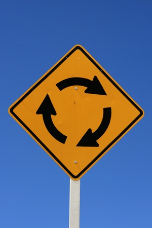 roundabout road sign with blue sky background Stock Photo - 8495531