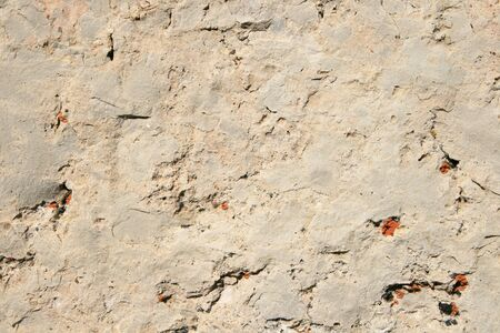 cracked white dolomite rock background with orange lichen spots Stock Photo - 8564305