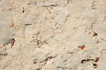 cracked white dolomite rock background with orange lichen spots Stock Photo - 8564305