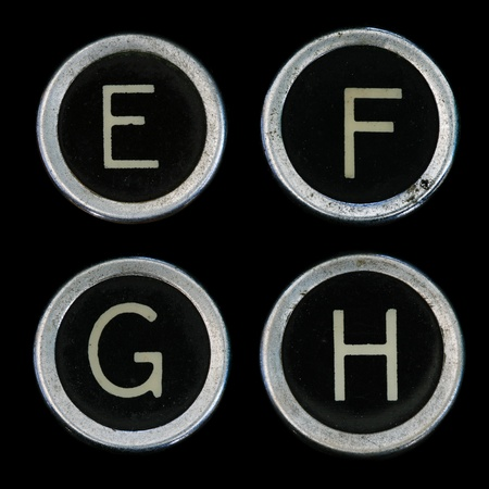 E F G H keys from old typewriter on black background Stock Photo - 8564308