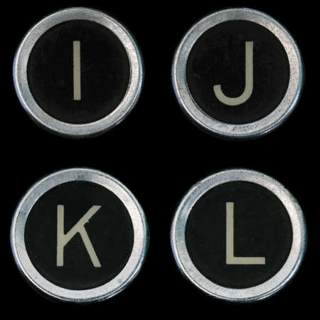 I J K L keys from old typewriter on black background Banco de Imagens - 8564312