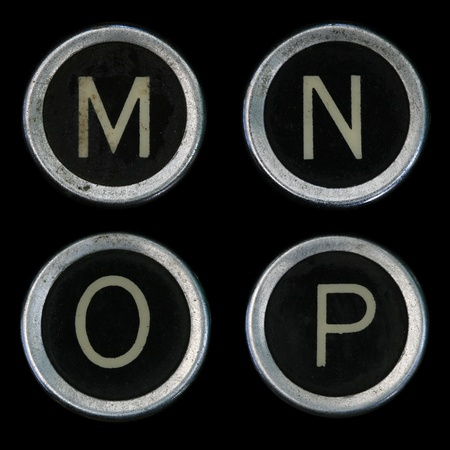old letters: M N O P keys from old typewriter on black background