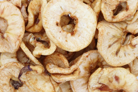 many dried apple rings as a background Stock Photo - 8597862