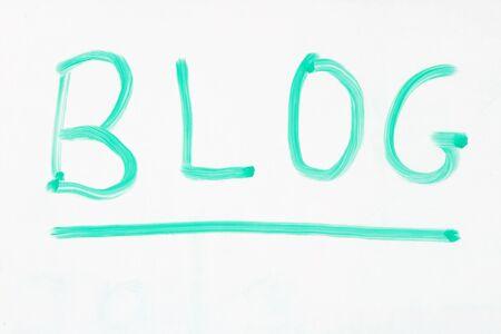 blog written on a whiteboard with a green marker Stok Fotoğraf