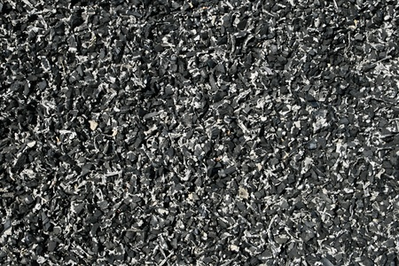 background of shredded pieces of rubber tire