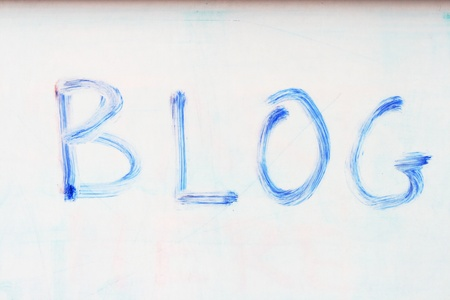 the word blog written on a whiteboard with an old blue marker