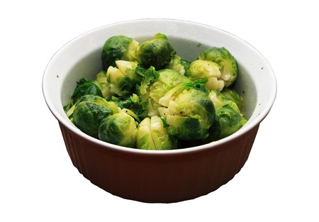 white bowl of cooked brussel sprouts isolated on white Stock Photo - 8832079