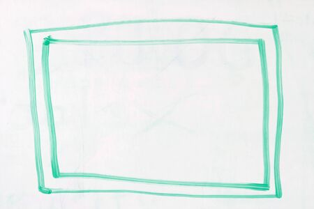 dry erase: box with double outline in green dry erase marker on a used white board Stock Photo