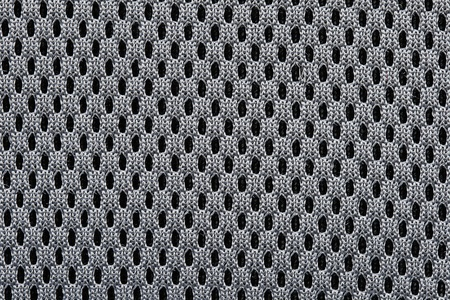 macro of woven black mesh textile background texture with regular holes Stock Photo - 8832095