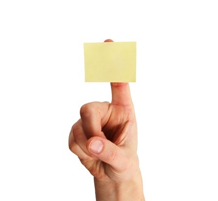 blank yellow sticky note on a womans finger isolated on white background