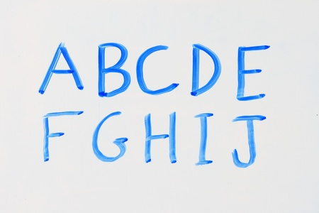 dry erase: the letters A B C D E F G H I J in blue marker on a dry erase white board