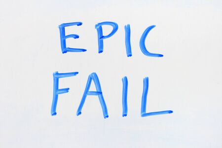 dry erase: epic fail written in blue marker on a dry erase white board
