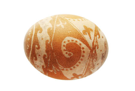 brown easter egg etched with vinegar and isolated on white Stock Photo - 8954299