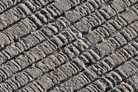 traction: textured concrete background with diagonal grooves to increase traction