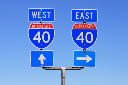 Interstate I 40 east and west road signs with blue sky background Stock Photo - 9112630