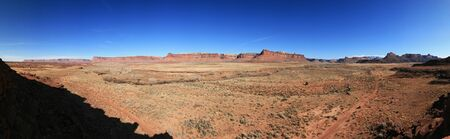 Indian creek desert panorama in Utah with distant cliffs, dirt road and sagebrush flats Stock Photo - 9178970