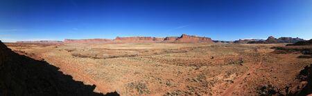 sagebrush: Indian creek desert panorama in Utah with distant cliffs, dirt road and sagebrush flats
