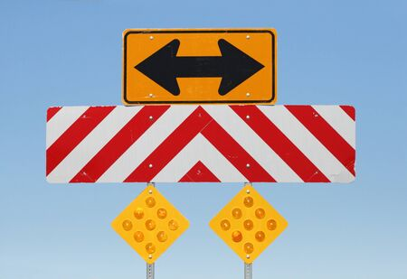 double sided arrow and reflective warning signs at a T junction on a road Stock Photo - 9178972