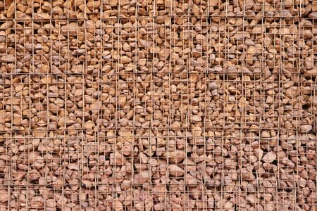 wire mesh: wire mesh gabion and loose rock retaining wall background Stock Photo
